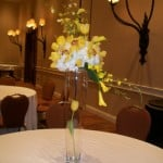 Tall wedding centerpiece with tulip, orchid and hydrangea