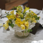 Flower and glass centerpiece with lemons