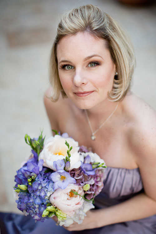 Bridesmaid with blue hydrangea and peony bouquet