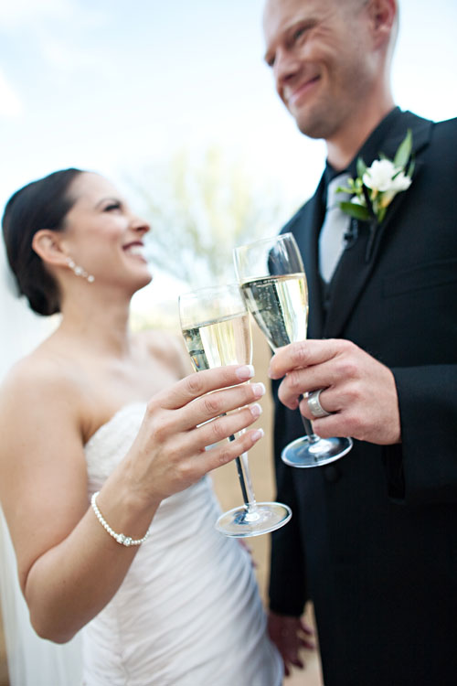 Bride and groom toasting with champagne